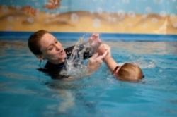 Fundamental Skills - Students that have completed GUPPY, FLOUNDER, GOLDFISH goals will be swimming with reaching arms (freestyle) and rolling to their back for a breath. This is the swim-float-swim method. Students will also begin to use their back stroke arms and back kicks (backstroke) across the pool.