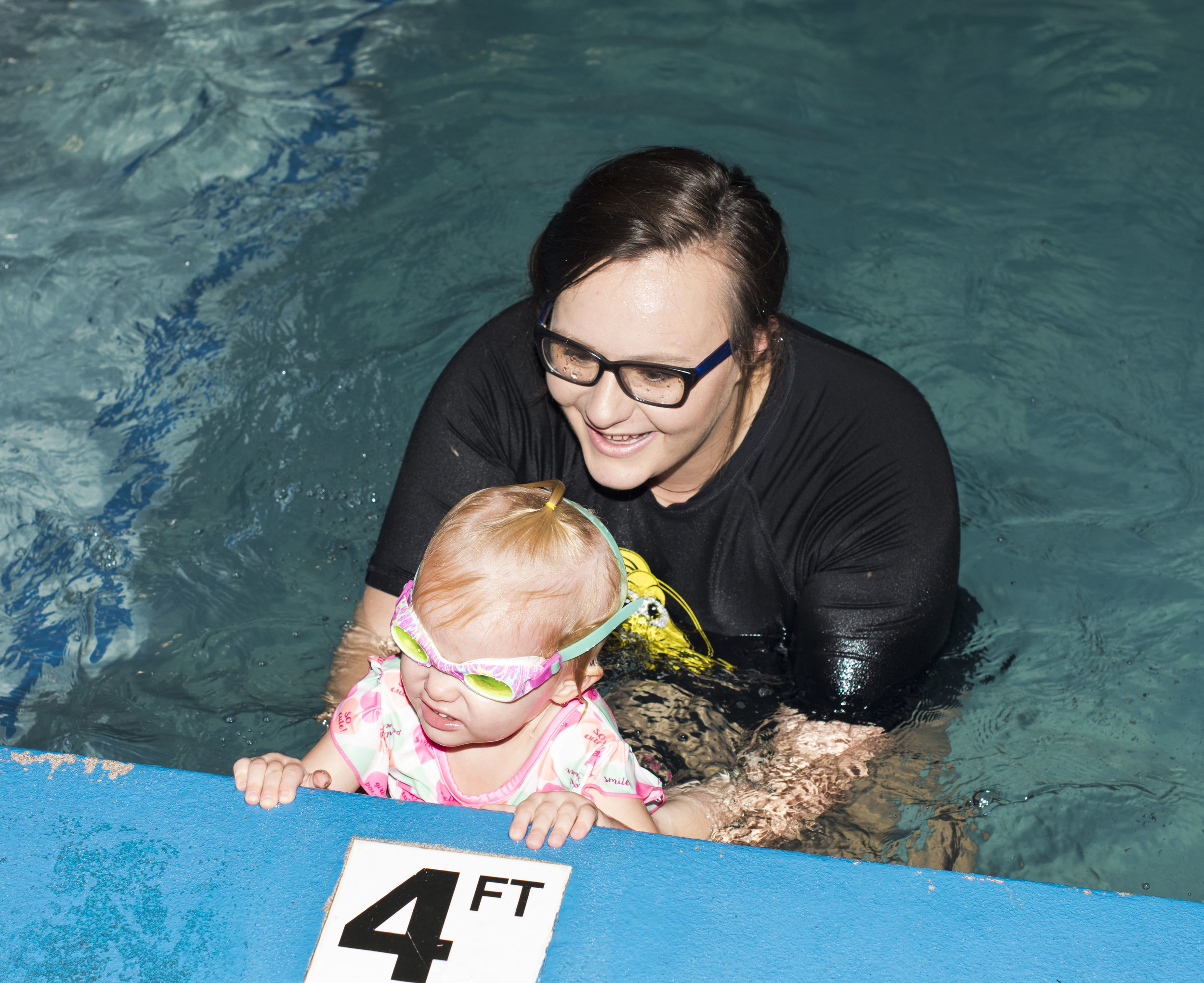 """Tadpole: Movement & Exit - """"I am learning to roll and swim-float-swim, and get out of the pool safely.""""Students that have completed TADPOLE goals are able to safely get from one side of the pool to the other using their back float to rest and breath along the way. Students may also get from one side of the pool to the other by using a back kick to get to the other side."""