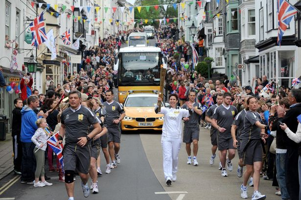 People gathered to watch the Olympic Flame on its journey throughout England. Summer Games 2012.