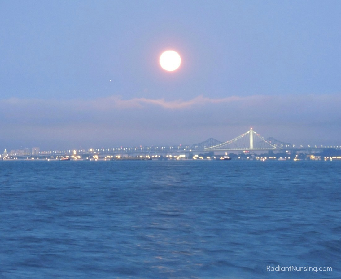 A super full moon over San Francisco Bay and the Bay Bridge.