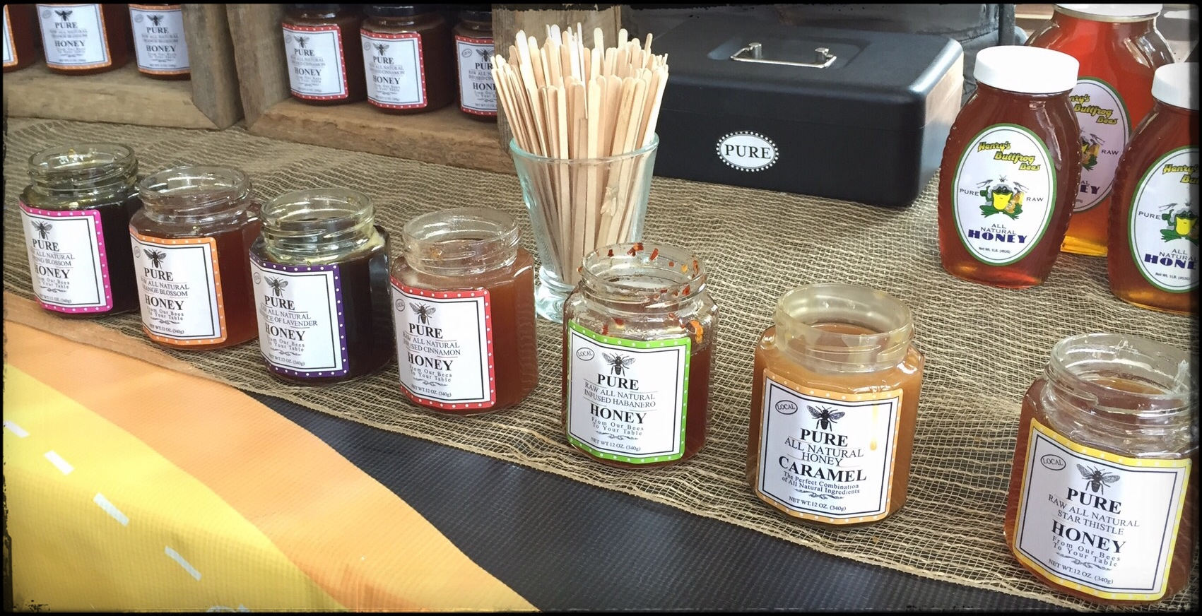 Tasting honey at the farmers market.