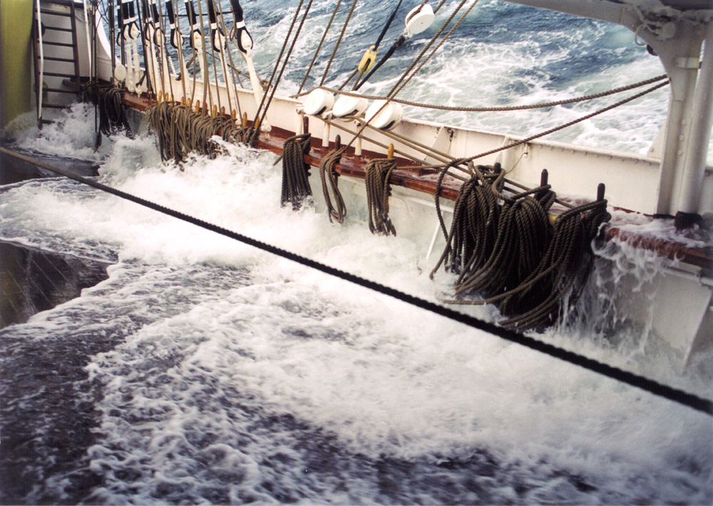 Belaying pins holding ropes on a ship in rough waters. Arrgggh, matey, be ye ready to sail with me? Pirates!