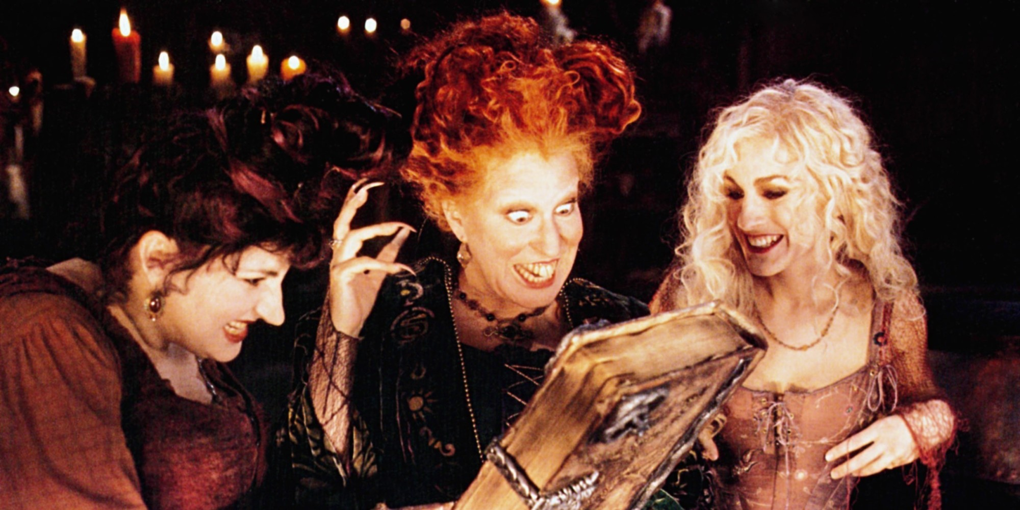 The Sanderson Sisters, three witches, concoct a magical spell from the Book of Magic. Hocus Pocus Halloween.