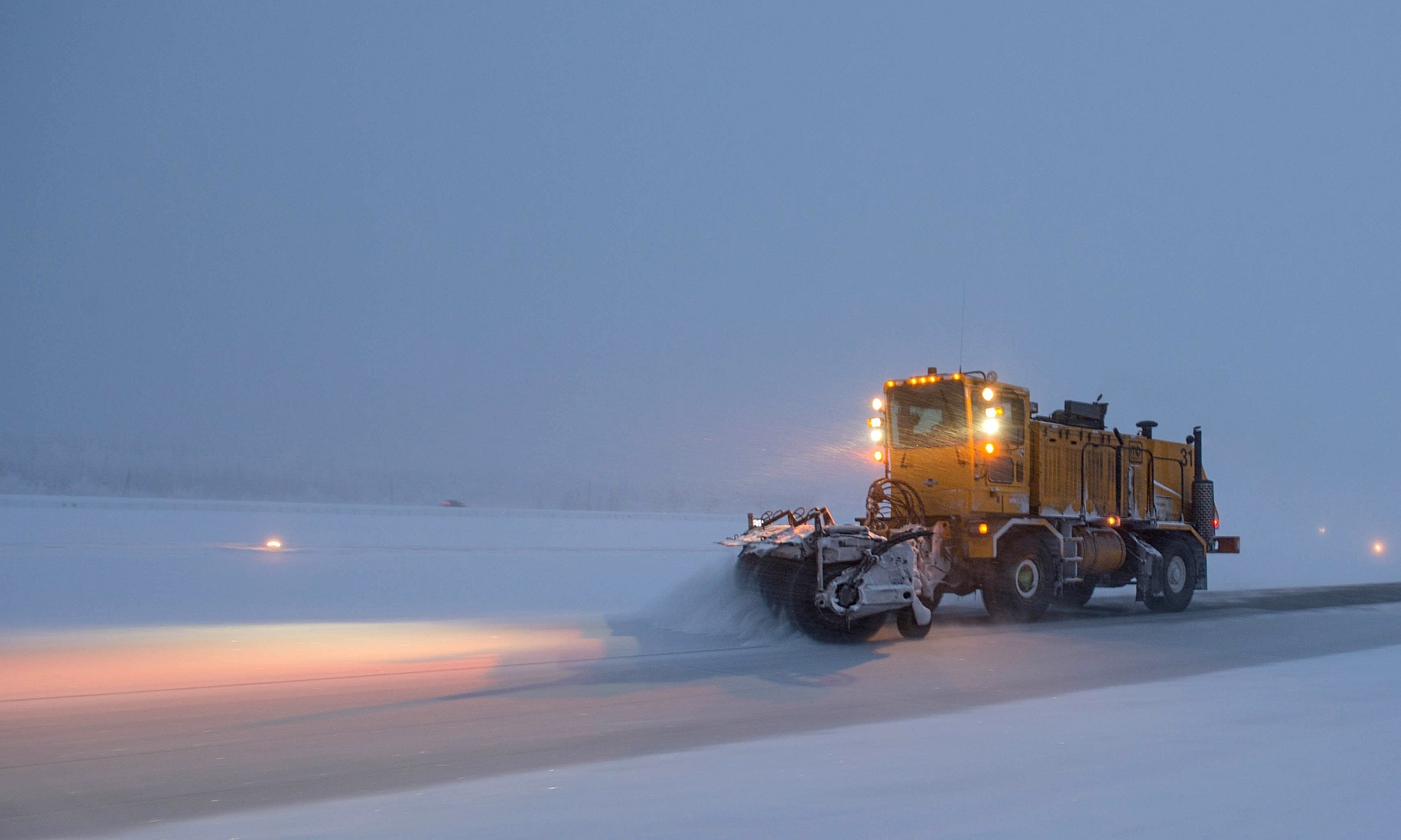 Snowplows are out to clear the roads during a snow storm.
