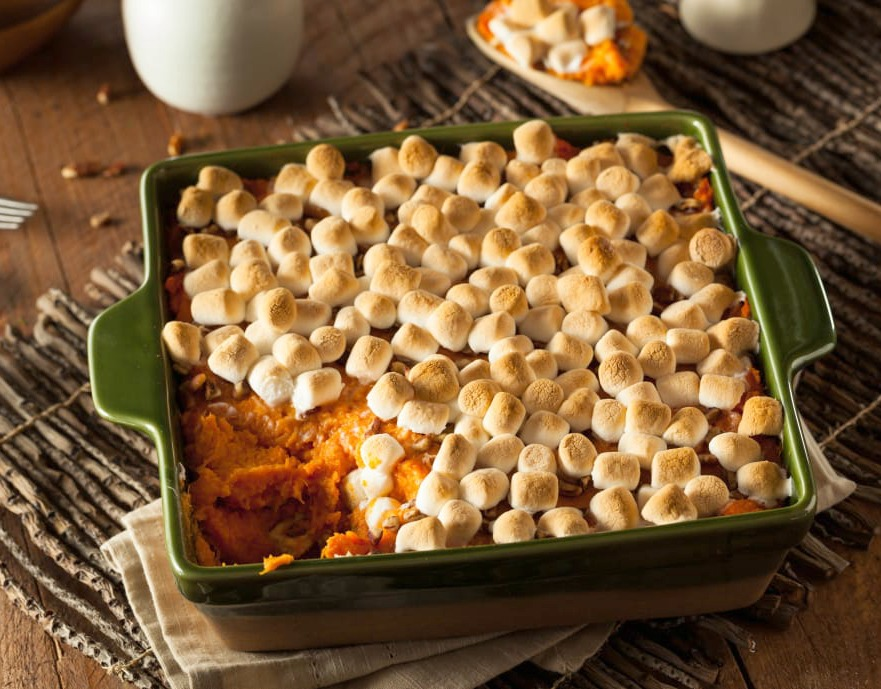 Candied yam casserole with toasted marshmallows on top. A Thanksgiving tradition.