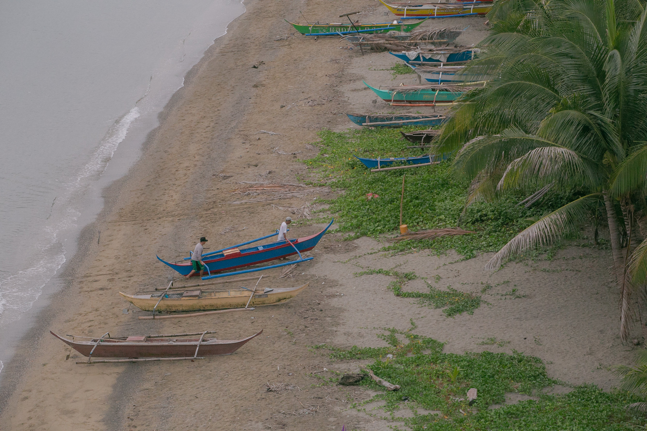 Fishermen park their boat at the beach in Punta Ilag, Oriental Mindoro. Punta Ilag is planning to expand its no-take zone from 12 hectares to 16 hectares.