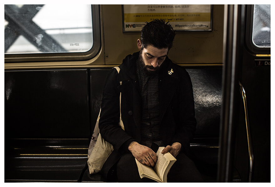 Man-reading-in-the-tube-NYC-Sebal-Sebastien-Alouf.jpg