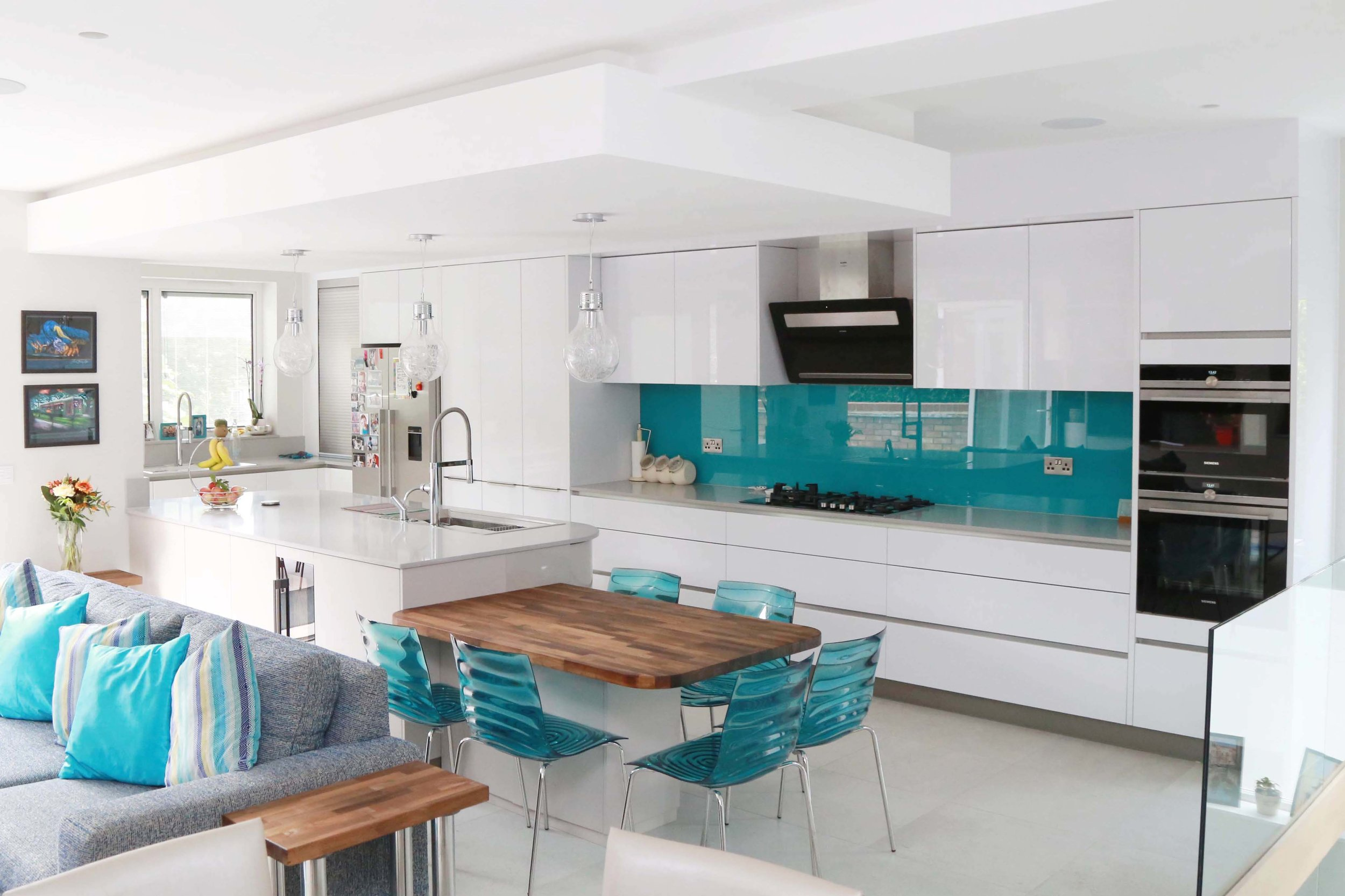 Crouch End, N8 - A large kitchen and feature wall designed using Lacquers, Walnuts and Glass.