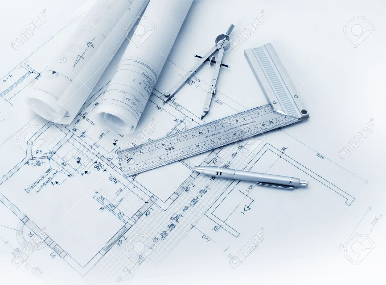 how-did-architect-draw-a-plan-construction-tools-and-blueprint-drawings-stock-photo.jpg
