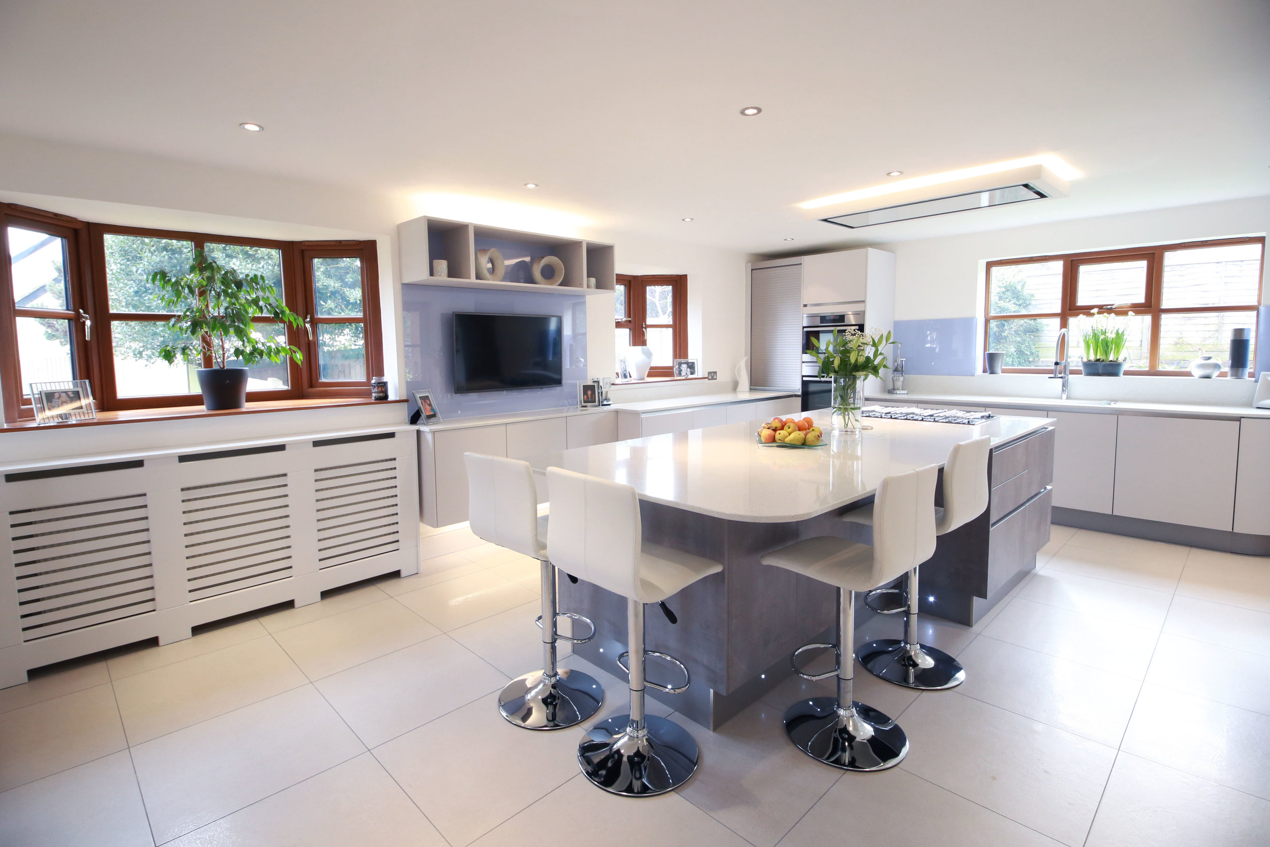 WELWYN, AL6 - A sociable kitchen combining a concrete style island and satin matt lacquer doors.