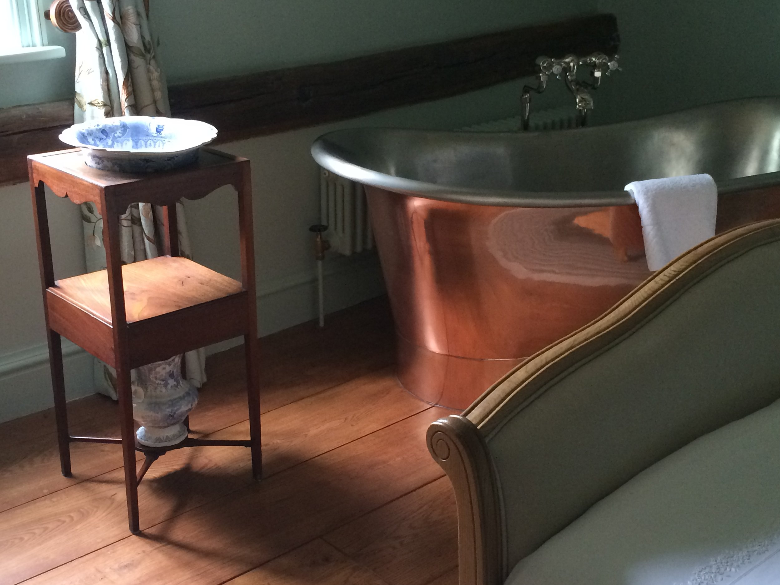 Copper bath in bedroom.