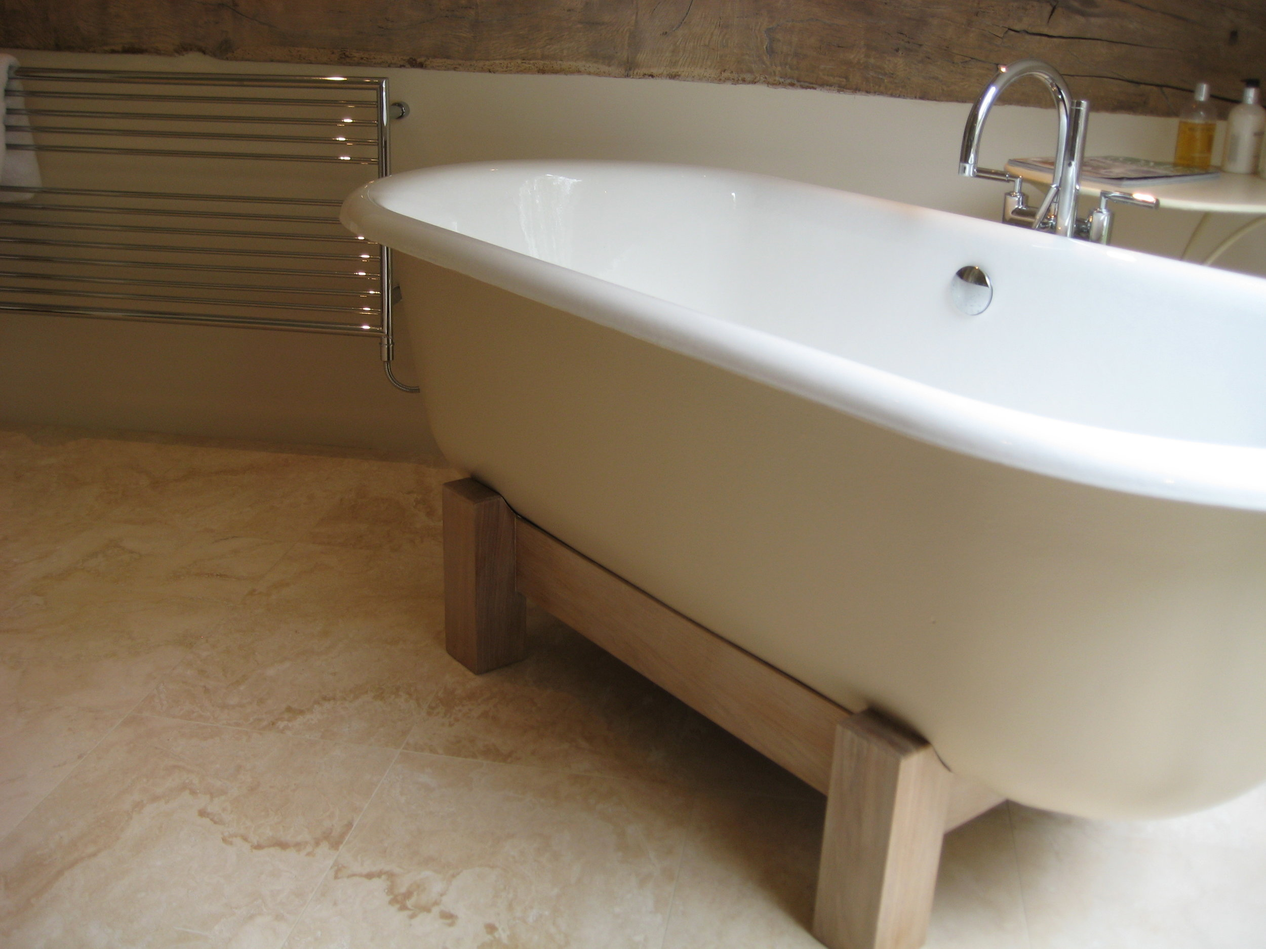Contemporary bathroom design with freestanding bath on timber legs.