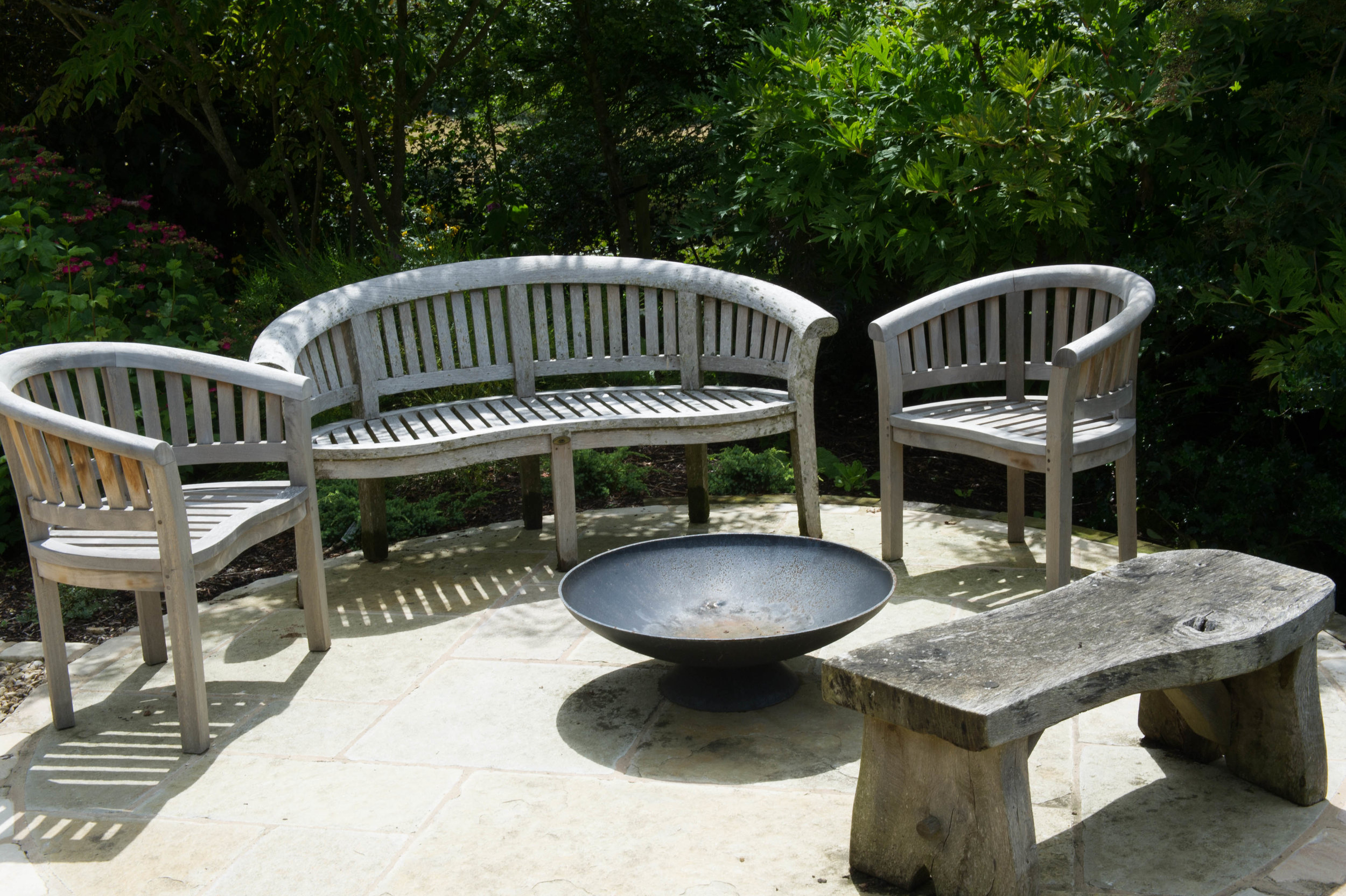 Timber garden furniture with firepit.