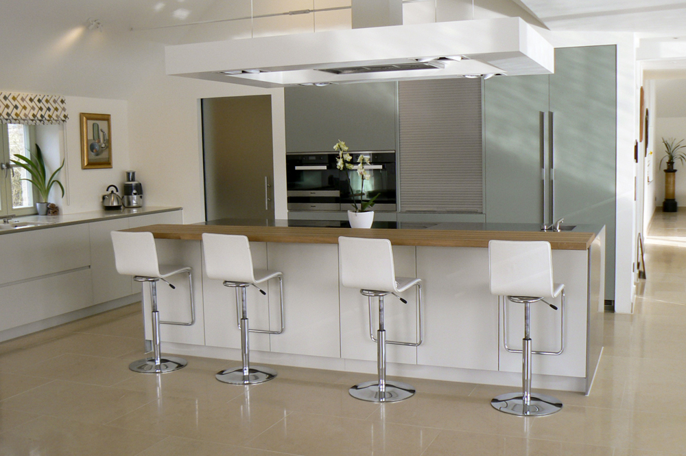 Kitchen design featuring island with barand white bar stools.