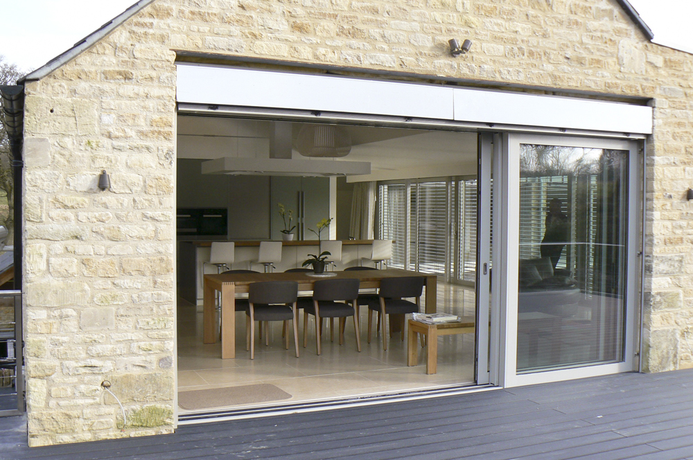 View into interior from external deck of cotswold stone water mill.