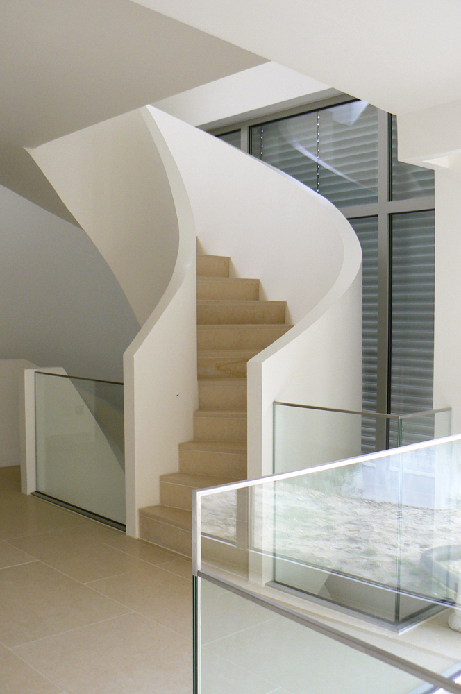 Contemporary staircase with glass balustrades.