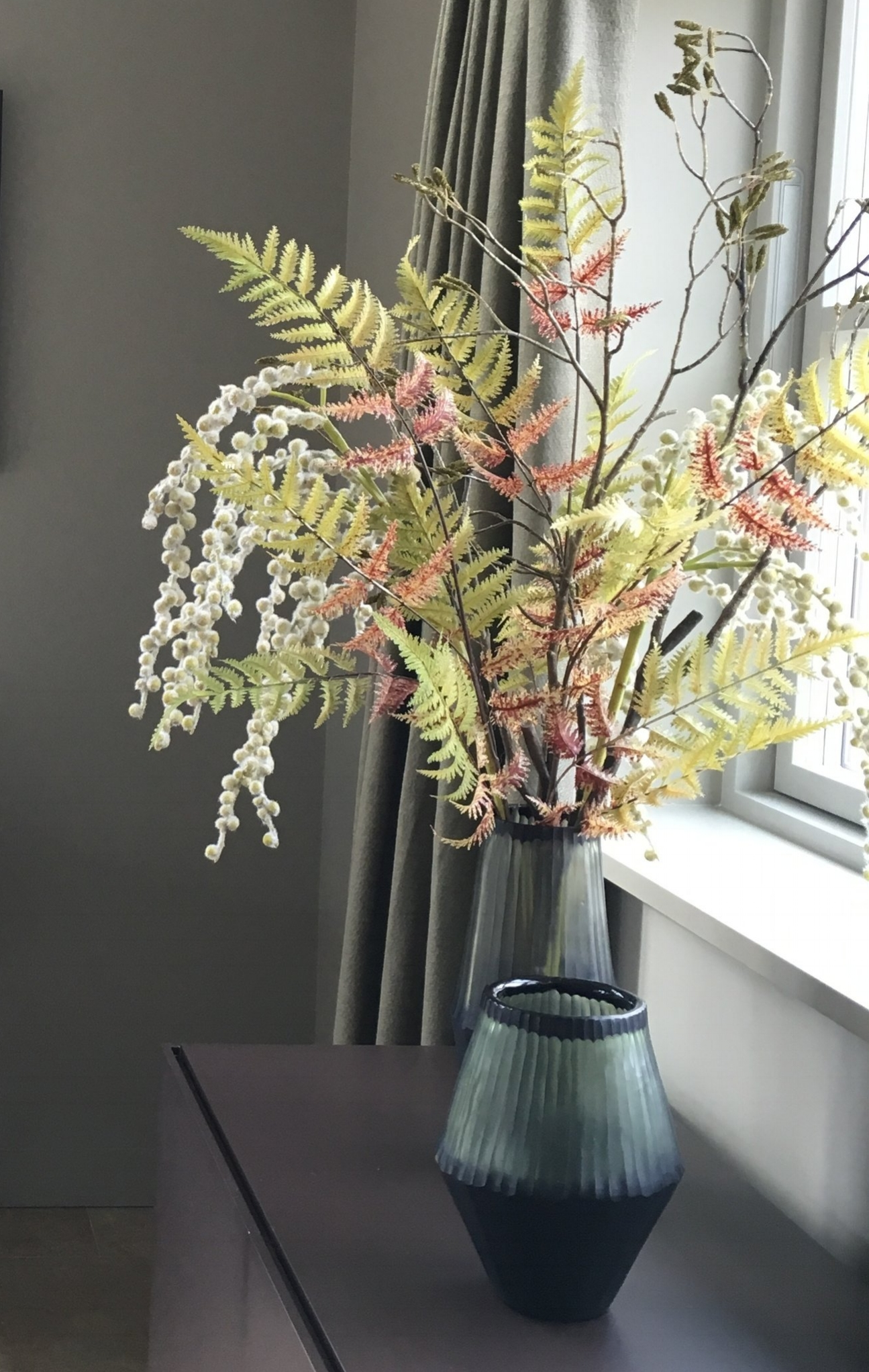 Faux flower arrangement in Dining room