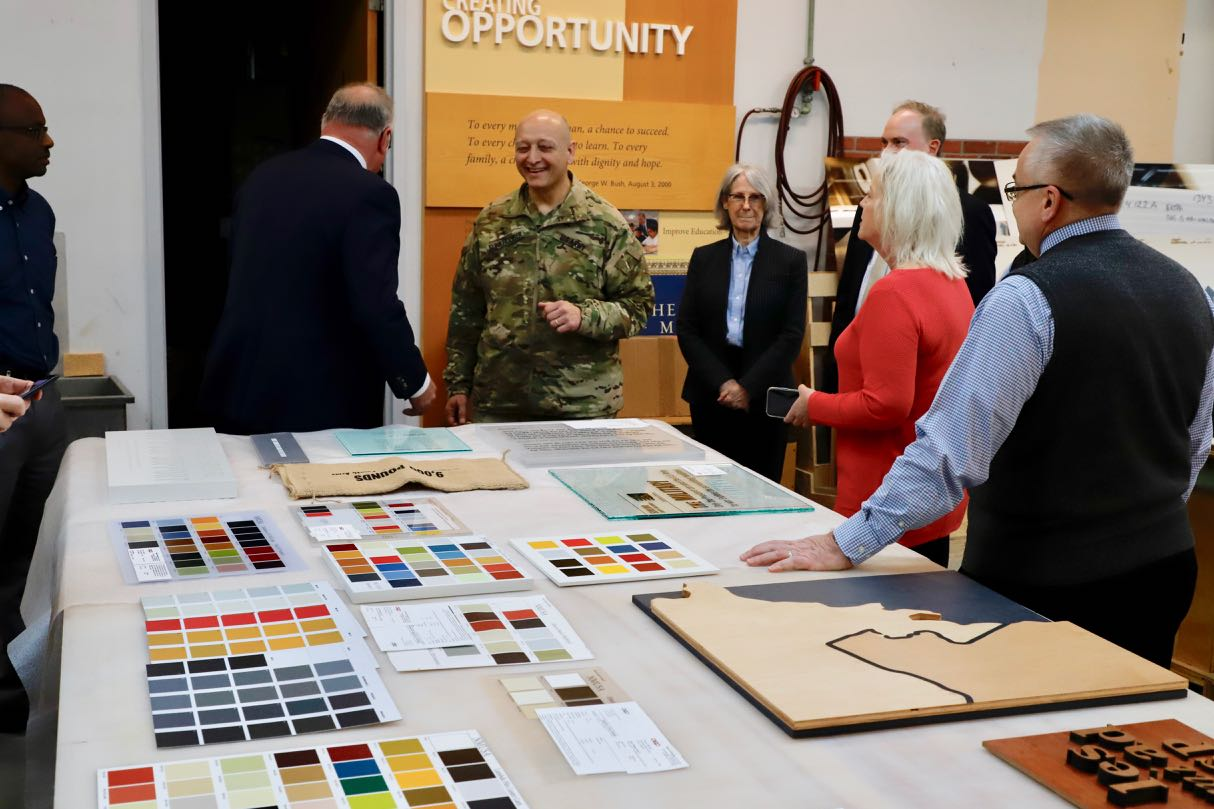 MG Anthony C. Funkhouser and National Museum of the United States Army staff members review graphic samples.