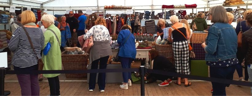 Shoppers in the sale marquee