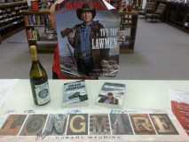"""Longmire"" books, wine, and autographsdonated by Carol Fritzler"
