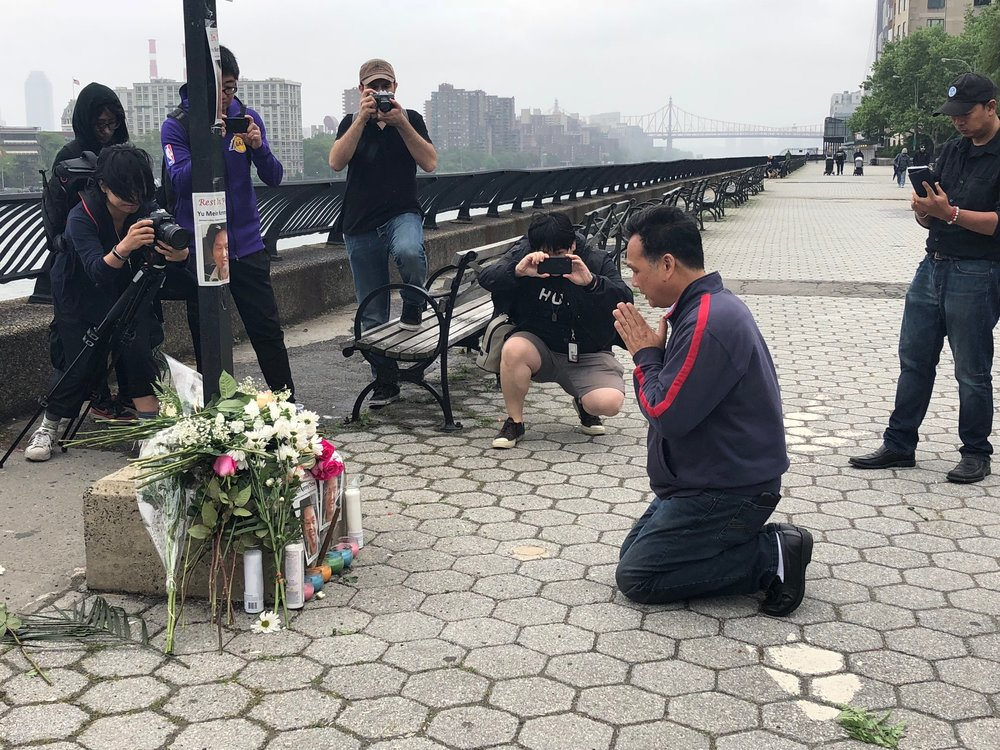 Richard Chow, Brother of Kenny Chow, praying at vigil on May 27th, overlooking the East River at 86th St & East End Avenue.