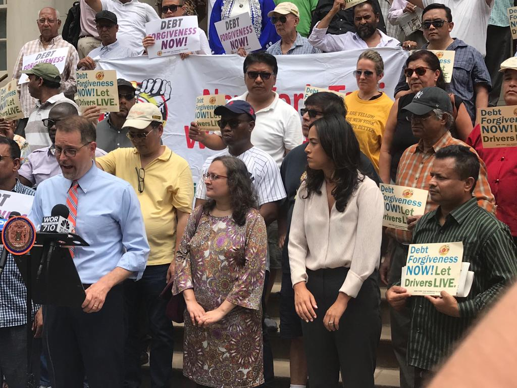 "NYTWA Members at a press conference with Council Members Mark Levine and Carlina Rivera on July 11, 2019 to tell the city, ""Debt Forgiveness Now!"""