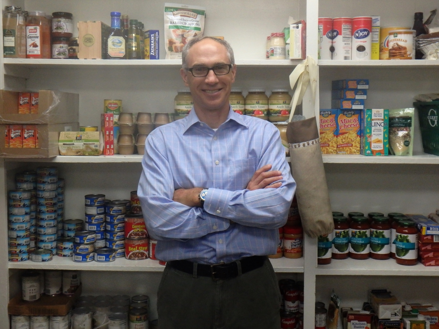 Paul Silvestri, Board President of  Samaritan Community,       stands in our food pantry - made possible by the generous support                                        of friends like you.