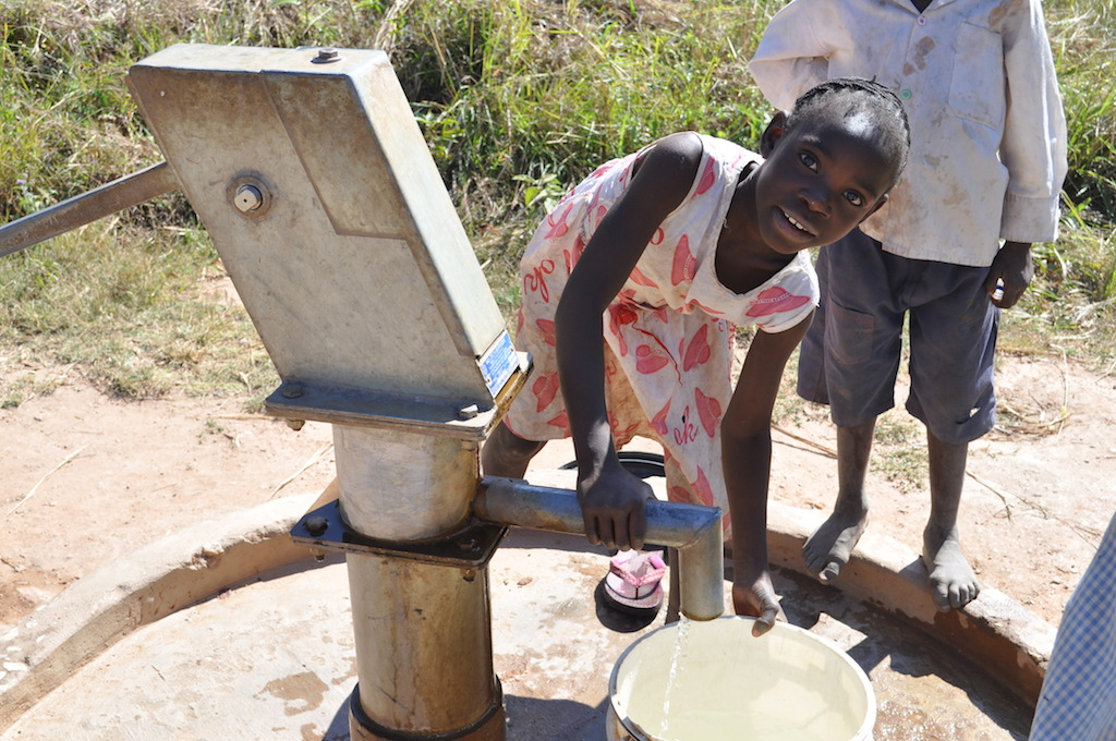 Sweet smiles while fetching water for family at Kunchubwi Village borehole