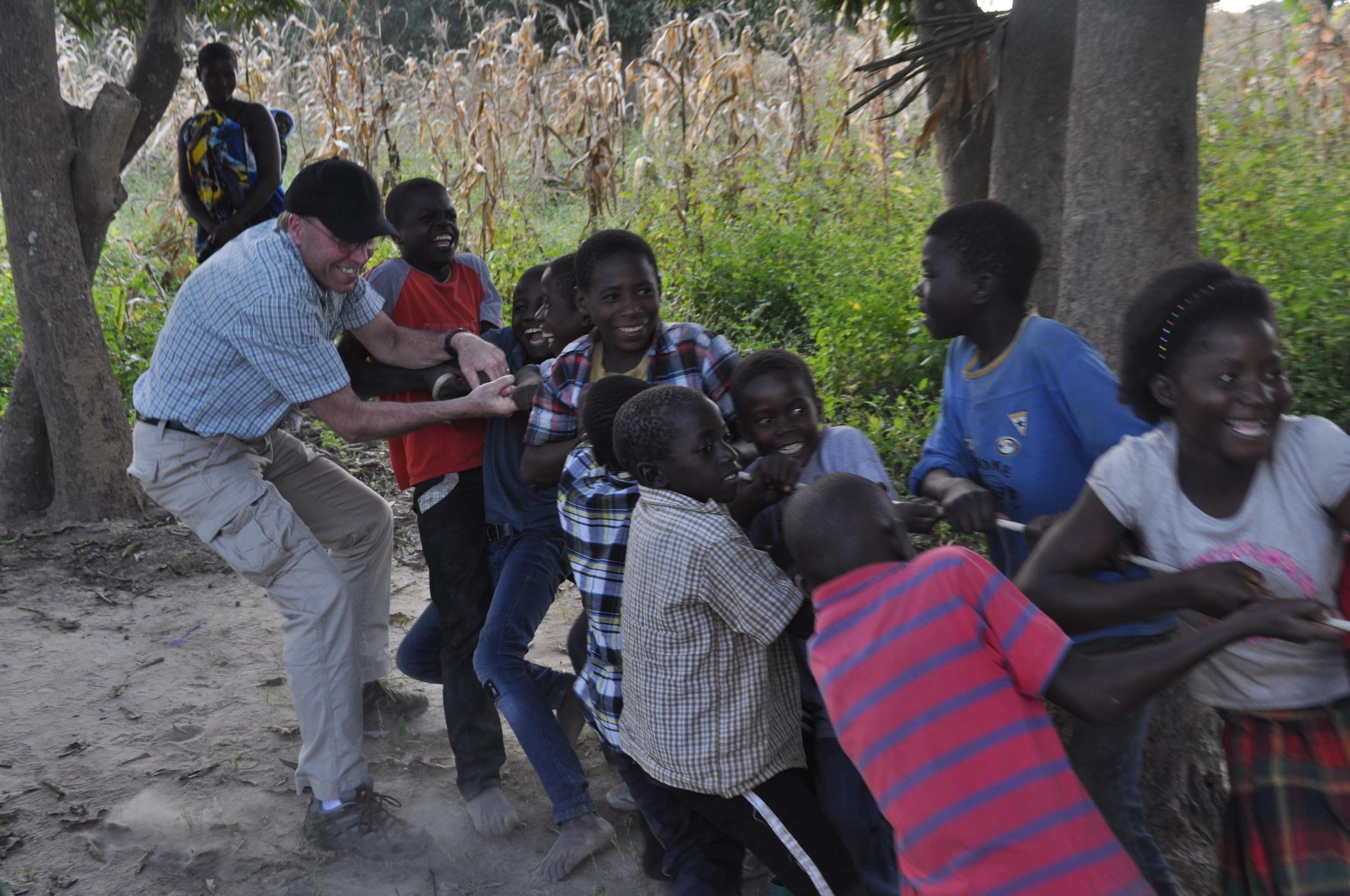 Tony playing with Kunchubwe kids in 2014