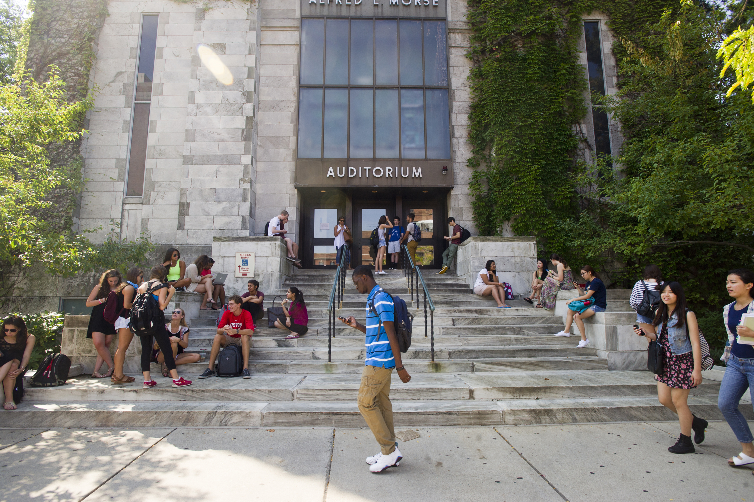Students come and go from class outside Alfred L Morse Auditorium in the morning of September 5, 2014.  Photo by Cydney Scott for Boston University Photography