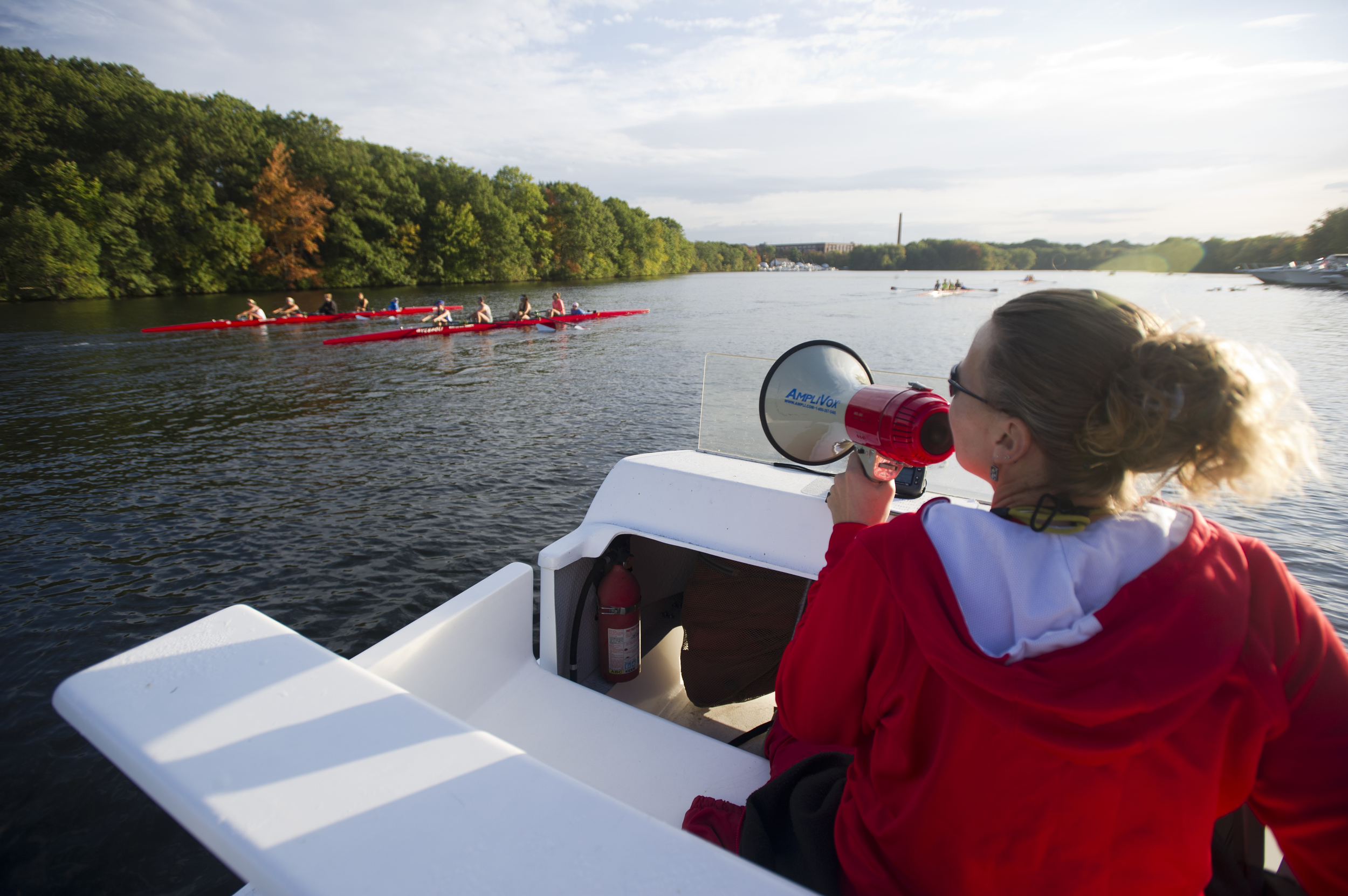 The BU Women's Crew Team coach Stacey Rippetoe does her thing on the Charles during an early morning practice October 7, 2014. Photo by Cydney Scott for Boston University Photography