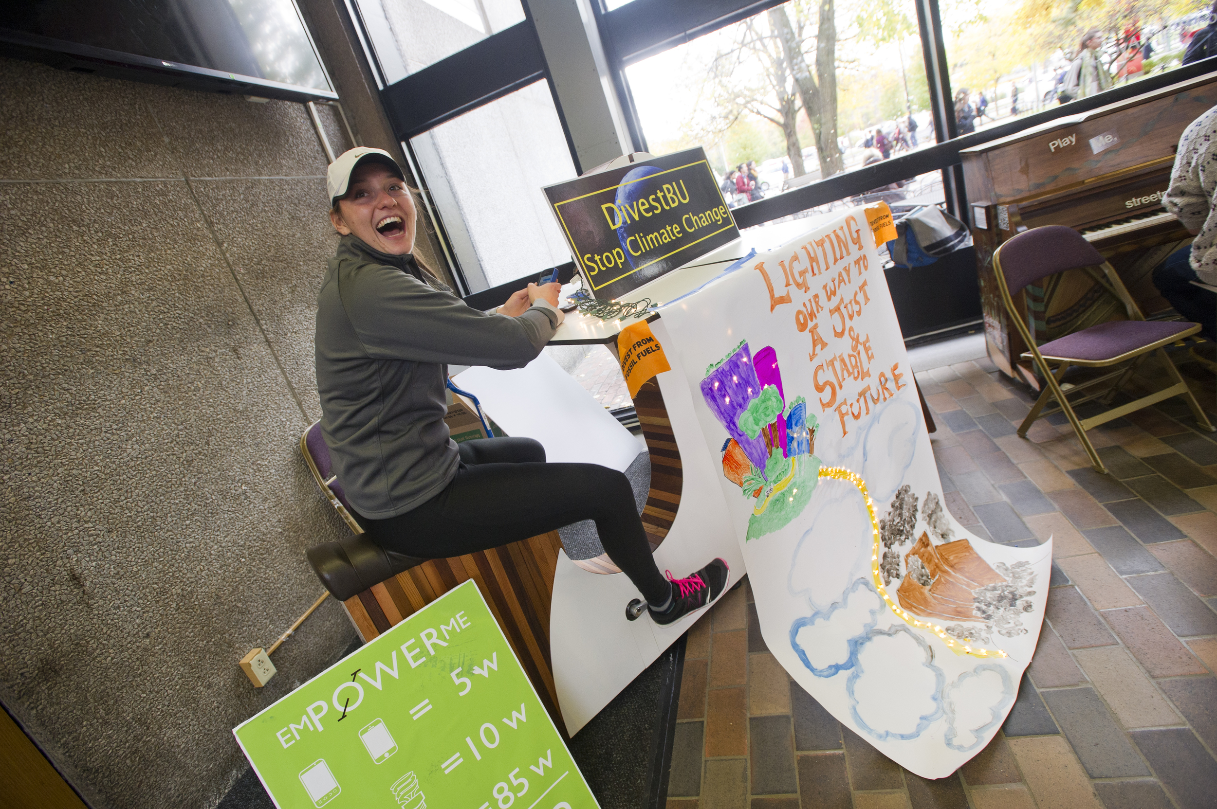 Claire Richer (CAS'15) from Students for a Just and Stable Future cycles to raise awareness of climate change in the GSU link November 7, 2014. The group was also sharing a petition in an effort to get BU to stop investing in fossil fuel companies. Photo by Cydney Scott for Boston University Photogra