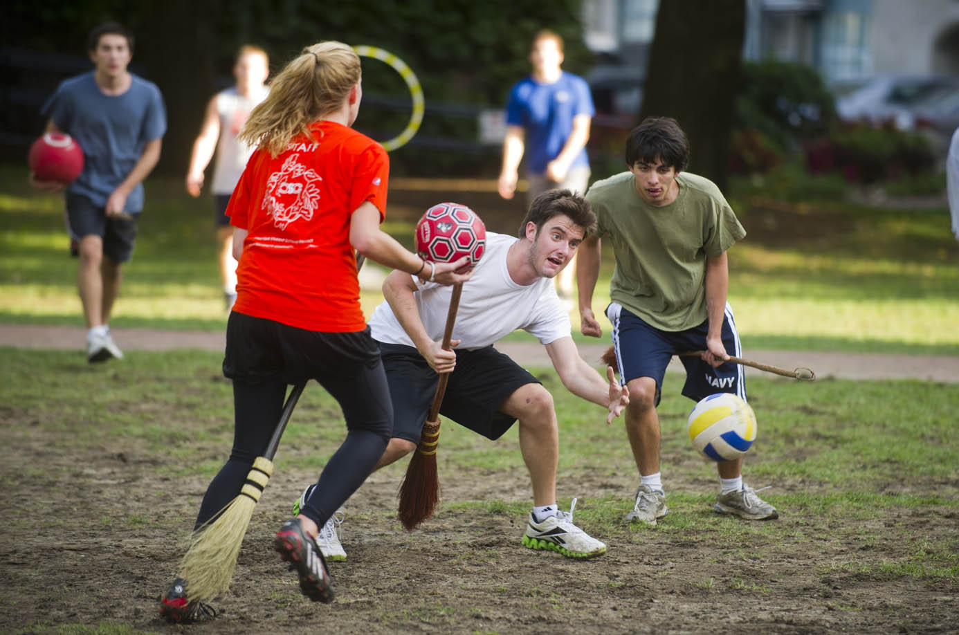 Angelino Placanino (CAS,'15) takes aim, center, while Caroline Stack (CAS,'12), left, and Bobby Heghmann (CGS,'15) right, look on during quidditch practice on BU Beach October 21, 2011. The trio are part of The Mandrakes, who are part of the BU Quidditch league. Photo by Cydney Scott for Boston University Photography