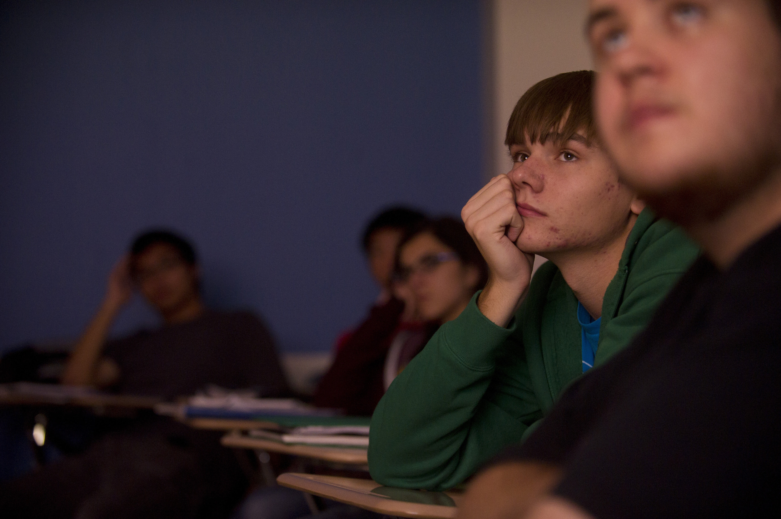 Nathan Hepler (ENG,'15) watches an episode of Battlestar Galactica during Joelle Renstrom's Evolution of Science Fiction class. Photo by Cydney Scott for Boston University Photography