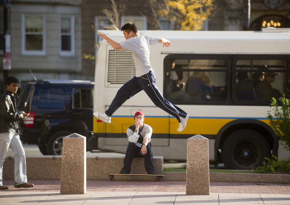 Justin Chen (CAS14) practices Parkour in Marsh Plaza October 21, 2011.  Originally developed in France, the main purpose of Parkour is to teach participants how to move through their environment by vaulting, rolling, running, climbing and jumping. Photo by Cydney Scott for Boston University Photography