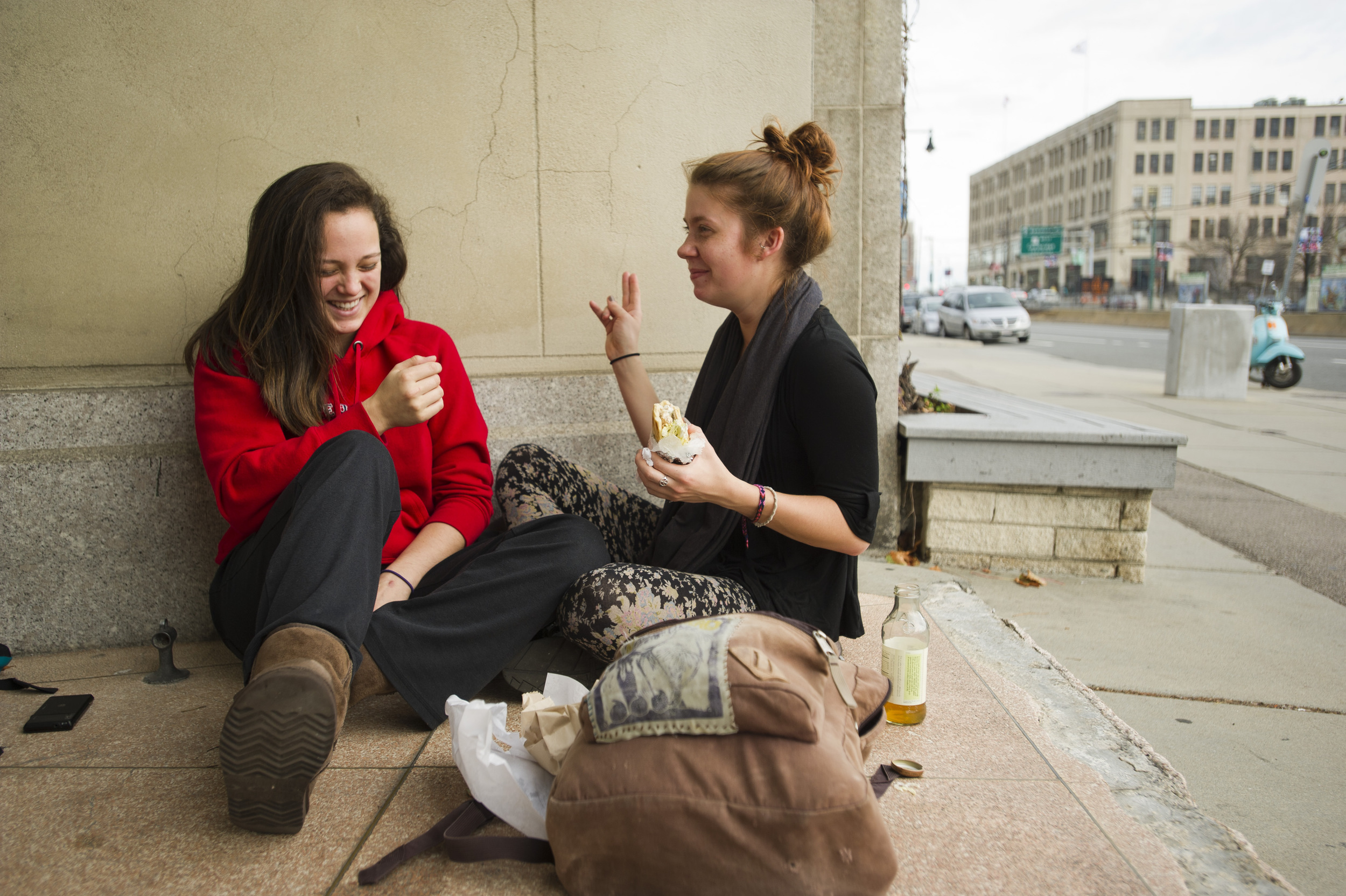 "Eliza Fichter (CFA,'13), left, and Caroline Rose Markham (CFA,'13) relax outside the CFA November 29, 2011 before rehearsal for ""The Shakespeare Project"" which both are acting in. The play of Shakespearean vignettes will be performed December 7 through 10 in the Theater Lab at CFA. Photo by Cydney Scott for Boston University Photography"