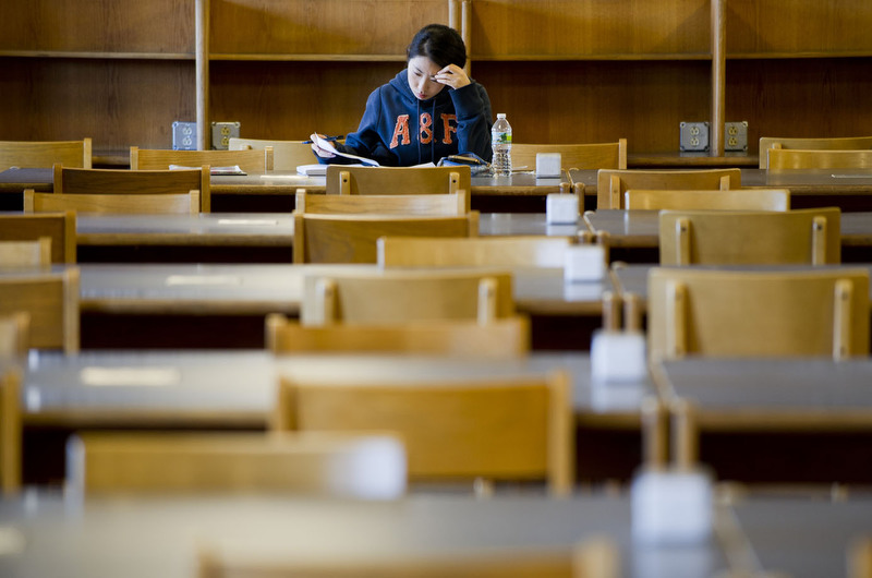 Jihyeon Lee (MET,'12) studies for her Actuary Science Exam in Mugar Library January 5, 2012. Lee says she stayed in Boston to study, rather than visit her home of South Korea during the break.  Photo by Cydney Scott for Boston University Photography
