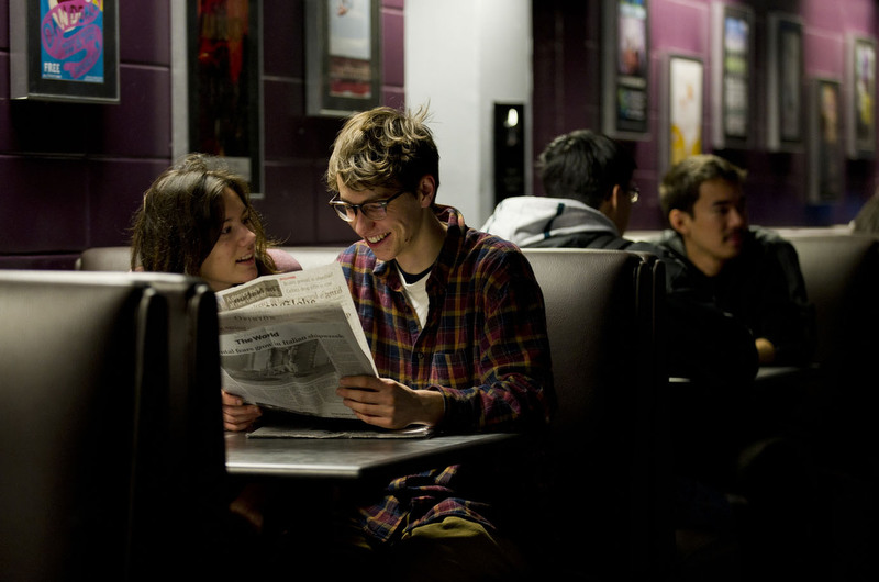 Chelsea Towson (CAS,'12) and her boyfriend Peter Szujewski (CAS,'12) look over a copy of The Boston Globe together while taking a break between classes at BU Central during the first day back to classes Tuesday, January 17, 2012.   Photo by Cydney Scott for Boston University Photography