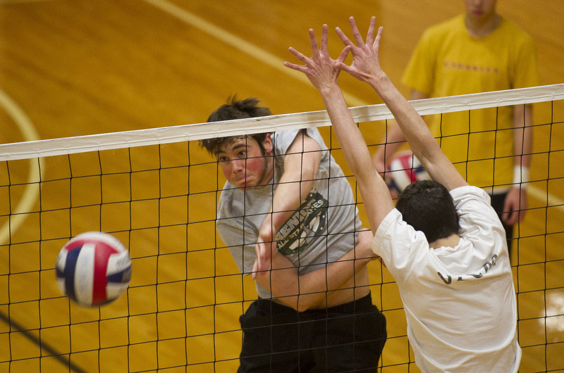 Max Laroche (CGS '15) spikes the ball during a men's volleyball club practice at FitRec January 24, 2012. The team, which has 16 members, practices three times a week.  Photo by Cydney Scott for Boston University Photography