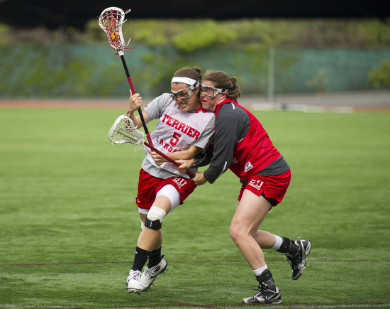 Elizabeth Morse (CGS'14), left, tries to keep possession of the ball with teammate Siobhan McCarthy (CGS'15) on defense during drills at BU women's lacrosse varsity team practice April 24, 2012 at Nickerson Field.