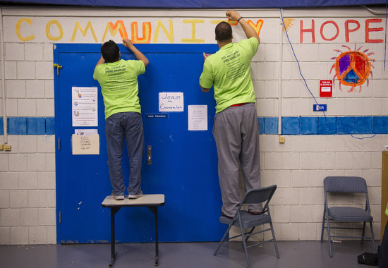 "Wrestler Michael Mayo (CGS'15), left, and basketball player Dominic Morris (CGS'14) work together on a mural at Jackson Mann Middle School Saturday April 28, 2012 as part of America East Spring Service Day. twenty five athletes from seven of BU's different sports teams volunteered their time painting murals which included words like ""peace, integrity, honesty, hope and respect""."