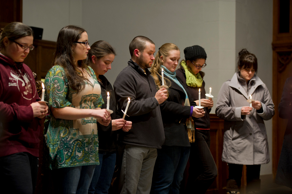 Twenty eight people, including Janjay Innis (3rd year STH), in yellow, and Rev. Dr. Robin Olsen, (to right of Innis), joined together for solace and remembrance December 17, 2012 at Marsh Chapel. Innis organized the vigil to help herself and others deal with their feelings towards the recent events at Sandy Hook Elementary in Newtown, CT. Photo by Cydney Scott for Boston University
