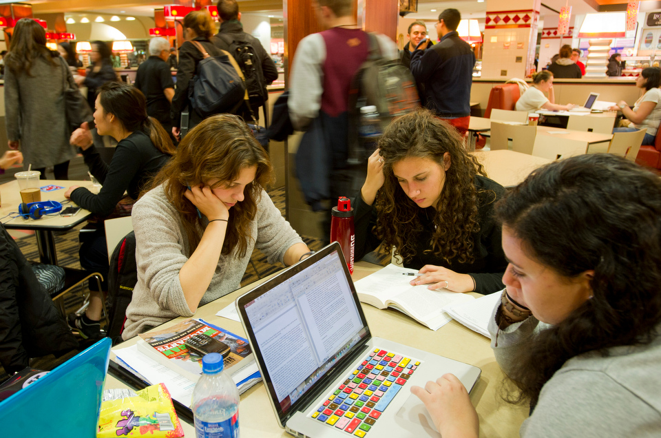 Jessica Hylek (CAS'15) from left, Julia Catalini (SED'14) and Vanessa Zarba (COM'15) grab a bite and hit the books int he GSU dining hall December 11, 2012 in preparation for finals.    Photo by Cydney Scott for Boston University