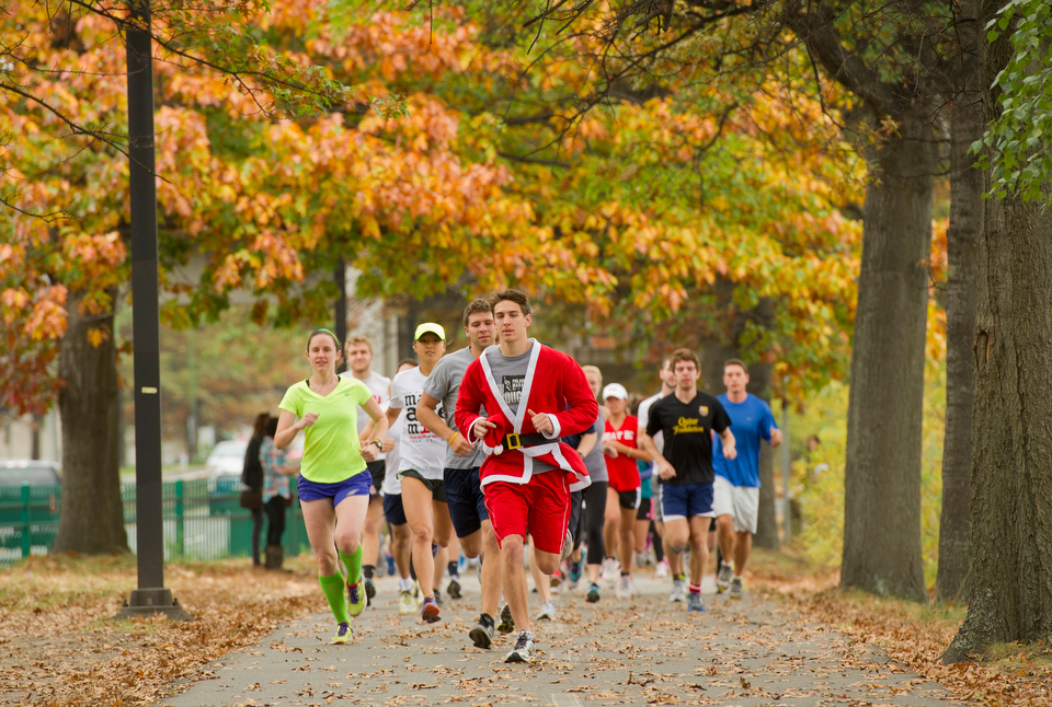 Participants in the 5K Run take off on the Charles River side of Storrow Dr. during the Trick or Trot Physical Therapy Fair October 26, 2012. About 65 people participated in the run, according to organizers.  Photo by Cydney Scott for Boston University