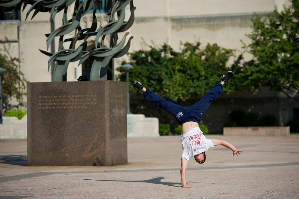 Corey Kronman (ENG'13) who is a member of the BU Free Running and Parkour Club works out in Marsh Plaza.   Photo by Cydney Scott for Boston University