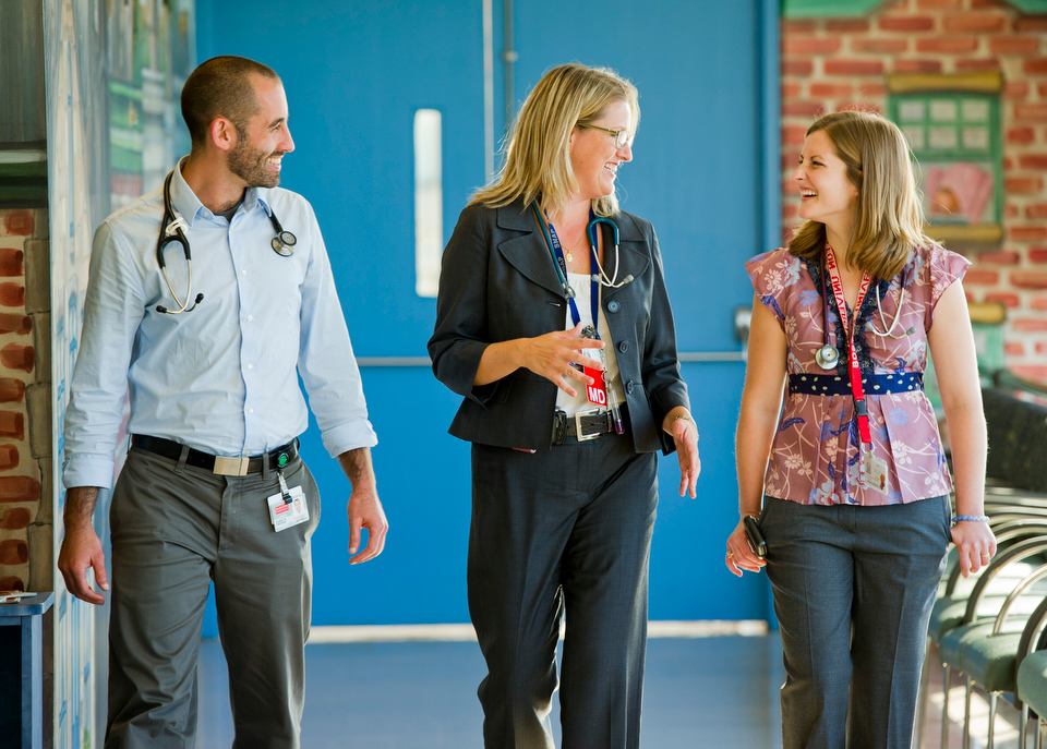 Student Advocacy Track Directors, Faculty Member Associate Professor of Pediatrics Megan Sandel (n gray), Lauren Feichtner who is Alumni Director, doing a fellowship at Children's Hospital , and Dan Dworkis -- 4th year MED student.  Photo by Cydney Scott for Boston University