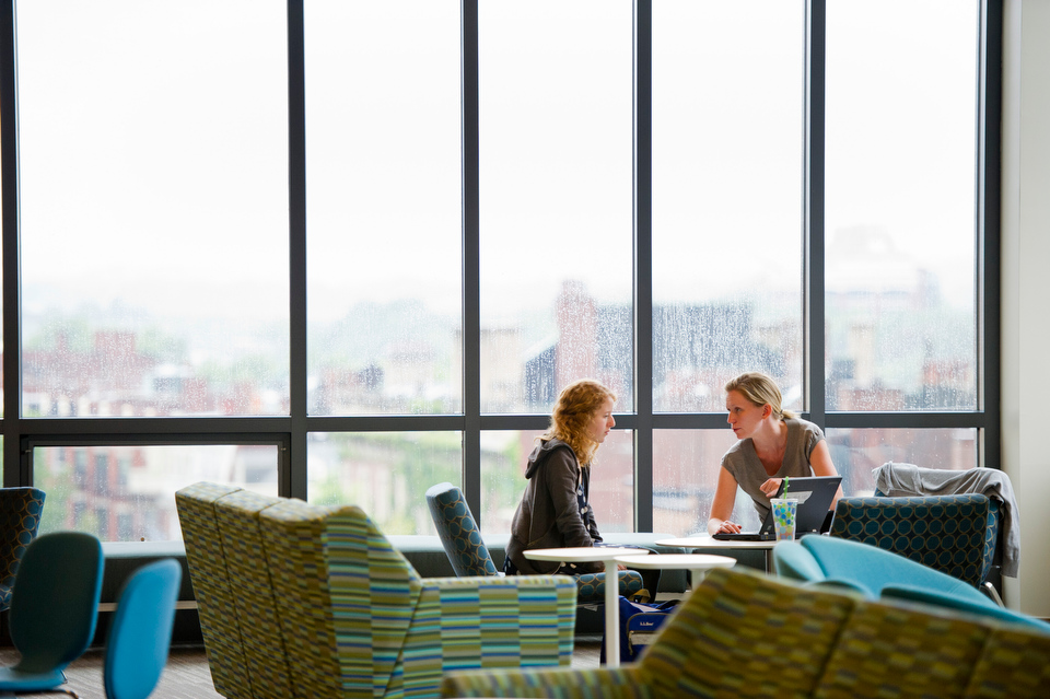 "Transfer student Isabella Tassinari (COM'15), left, gets some advice from Jesse Ohrenberger, Assistant Director Counceling and Programs on the fifth floor of 100 Bay State Rd where the Center for Career Development is now located in the new Student Services Center. Tassinari was taking advantage of ""Quick Questions"",  a service provided by CCD to answer questions about internships and jobs.   Photo by Cydney Scott for Boston University"