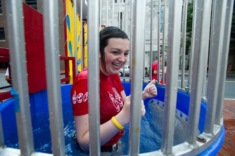 Rachel Power (CAS'14) makes the plunge for the Deaf Studies Club during BU's Comm Ave Fair September 7, 2012.   Photo by Cydney Scott for Boston University