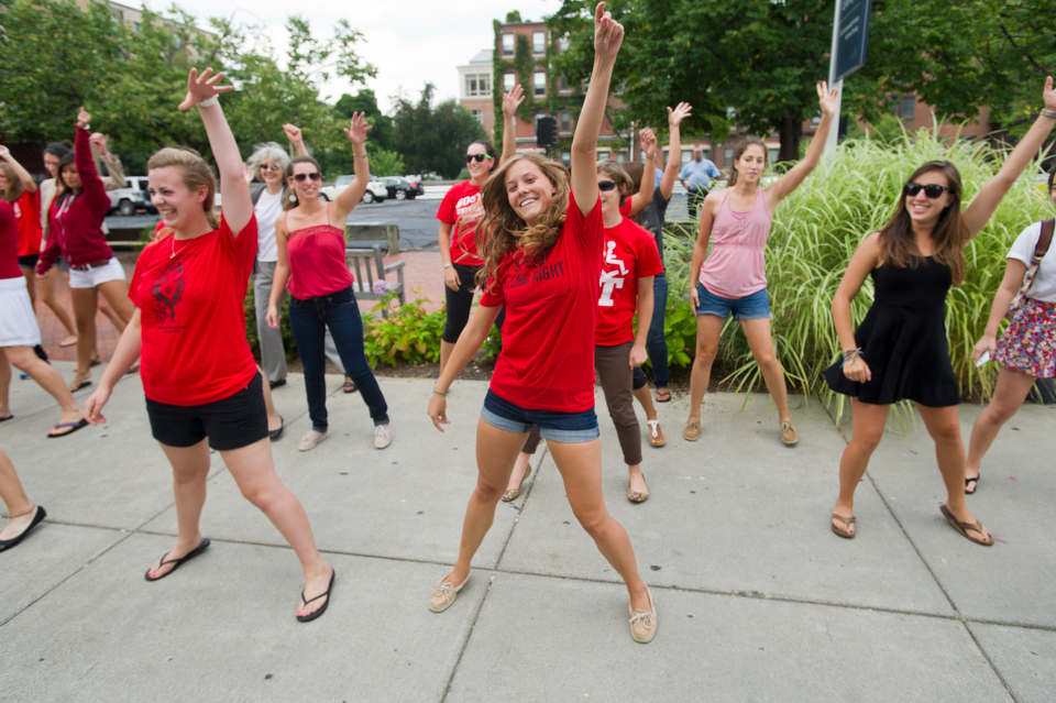 """Students, including Michelle Saulnier (SAR'13), at center, and faculty from Sargent College perform a choreographed number to Carley Rae Jepsen's """"Call Me Maybe"""" during BU's Comm Ave Fair September 7, 2012.  Photo by Cydney Scott for Boston University"""