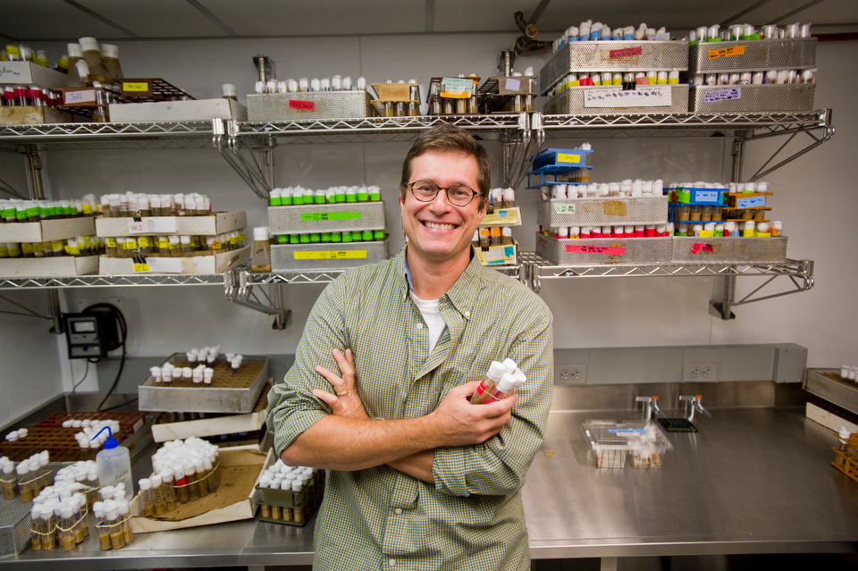 "Prof. Horacio Frydman (CAS-BIO) in the ""10 Degree Room"" where his flies are stored. He is doing research on how Wolbachia bacteria manipulates insect reproduction. They were photographed in the ""Fly Room"" at 24 Cummington Street September 10, 2012.   Photo by Cydney Scott for Boston University"